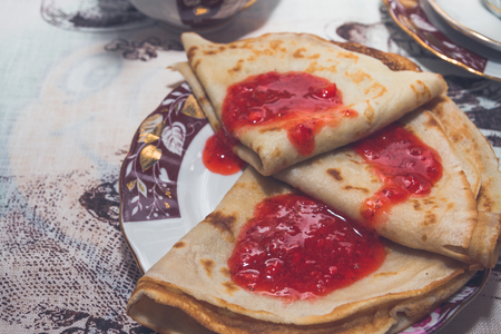 Pancakes with fresh strawberry jam for Breakfast