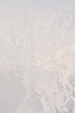 Winter frosty patterns on the frozen ice window Stock Photo
