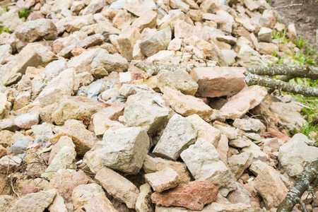 Stones and broken bricks lie in a pile on the street Stok Fotoğraf