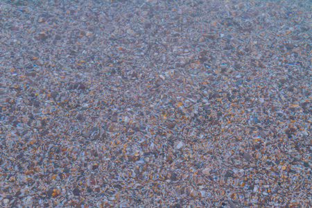 Sea stones in the summer sea before sunset Stock Photo