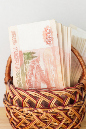 A lot of Russian money in denominations of five thousand rubles are in the basket