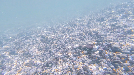 Photo underwater bottom of the Black sea with stones and pebbles in summer