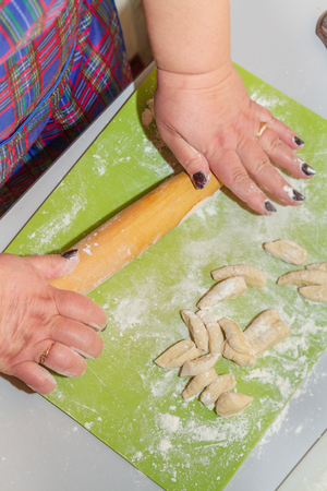 Preparation for cooking homemade dumplings woman chef at home