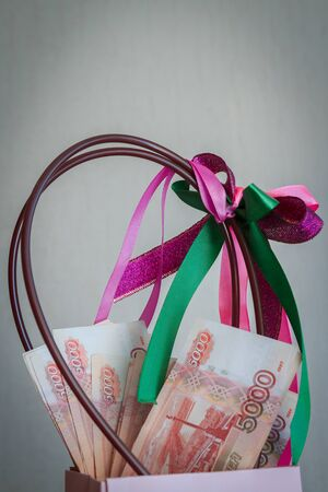 A large pack of Russian money lies at the gift package Фото со стока - 129215324