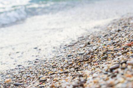 Sea stones on the seashore in the summer Фото со стока - 129217572