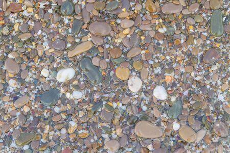 Sea stones on the seashore in the summer Фото со стока - 129210466