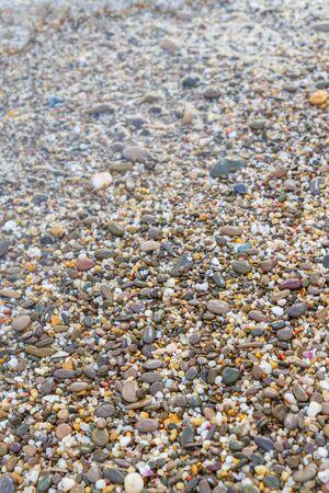 Sea stones on the seashore in the summer Фото со стока - 129219326