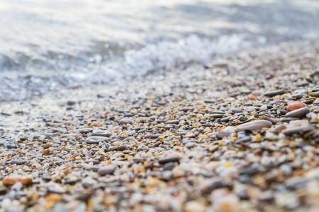 Sea stones on the seashore in the summer Фото со стока - 129219334