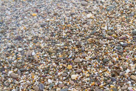 Sea stones on the seashore in the summer Фото со стока - 129212072