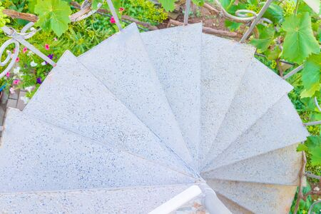 Gray spiral staircase at the private house in summer Фото со стока