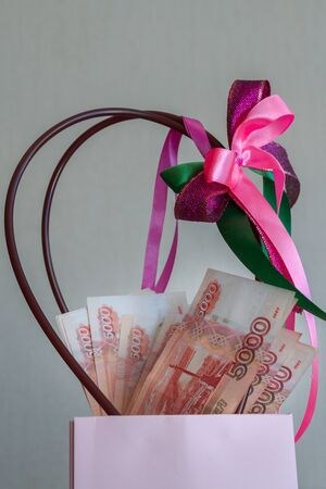 A large pack of Russian money lies at the gift package Фото со стока - 129212661
