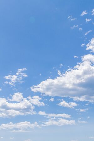 White fluffy clouds in the blue sky in summer 스톡 콘텐츠