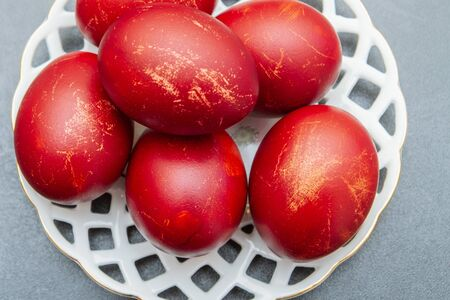 Dyed eggs in onion skins are at the plate