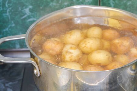 New potatoes boil in their skins in a saucepan