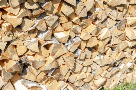 Dry chopped firewood lay in a pile on the street