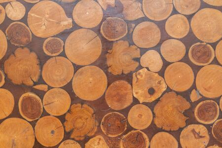 Wooden texture of the table top for cooking with a pattern of round logs