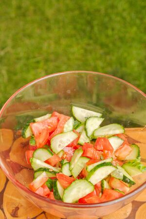 Preparation of salad of fresh vegetables and herbs Фото со стока