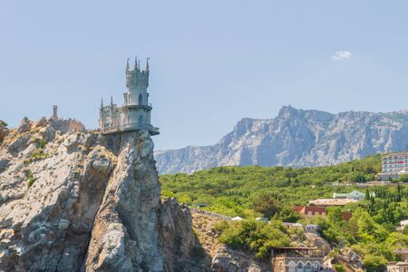 city of Yalta, Crimea, Russia 02 July 2019. The famous place of Crimea Castle Swallows Nest on the rock 新聞圖片