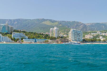 city of Yalta, Crimea, Russia 02 July 2019. Embankment of the city of Yalta on a Sunny summer day sea view