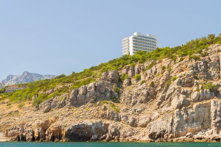 city of Yalta, Crimea, Russia 02 July 2019. The multi storey hotel is located on the shore of the rocky coast