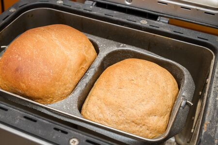Homemade bread is baked in a bread maker