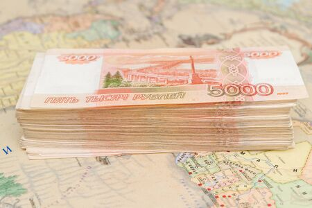 A large wad of Russian money is on the map of the world