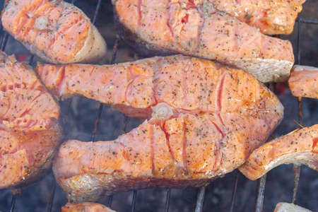 Large fish steaks fresh trout fried in spices on the grill