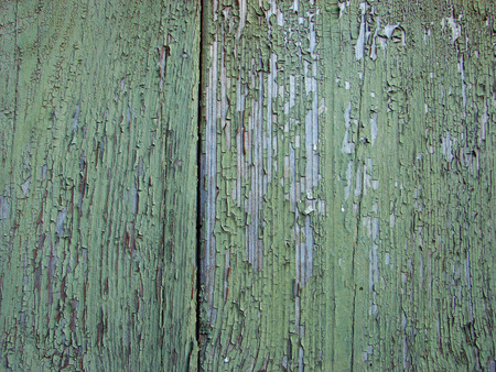 Peeling paint on wooden wall. Old wood texture