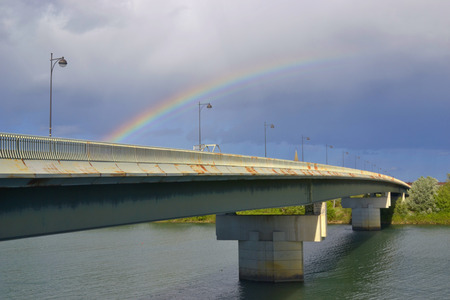 Rainbow above the bridge across the Rhone river between cities of Beaucaire and Tarascon. France