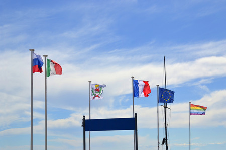 Flags fluttering against blue sky with clouds. Russia, France, Italy, European Union, rainbow LGBT flag Stok Fotoğraf