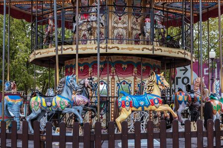 Old carousel in the amusement Park on a summer day without people