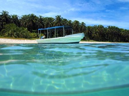 Boat near a paradise beach in Zapatillas islands, caribbean sea, Panama photo
