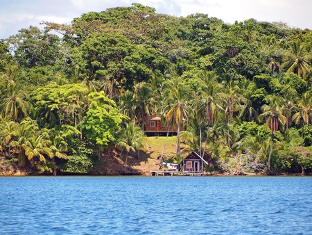 archipelago: Caribbean house and cabin with coconuts trees in archipelago of Bocas del Toro, Panama