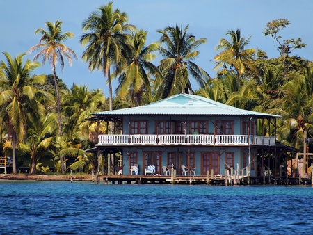 honduras: Beautiful typical hotel over the sea with coconut trees Editorial