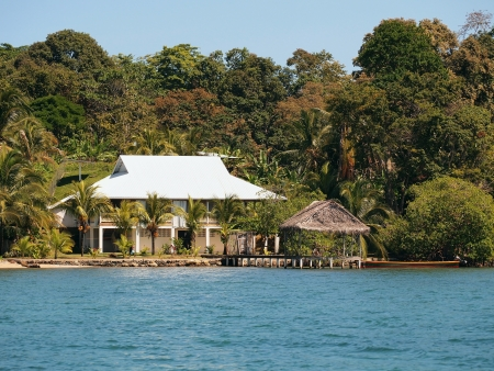 palapa: Tropical house on the beach with coconut trees and a palapa over the sea