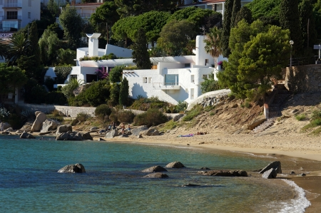 seafront: Mediterranean beach with beautiful house at Canyelles village in Costa Brava, Catalonia, Spain Editorial