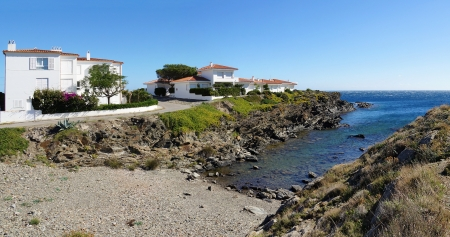 beach front: Panoramic view over a cove with Mediterranean houses in the village of Cadaques, Costa Brava, Catalonia, Spain Editorial