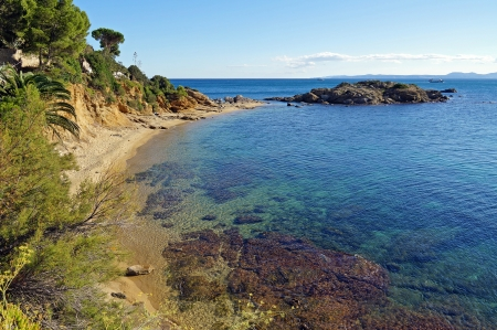 Beautiful Mediterranean beach with clear waters and a small rocky island, Costa Brava, Catalonia, Spain Stock Photo