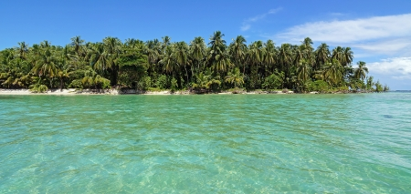 Panoramic view on a pristine island with lush vegetation and clear shallow water, Bocas del Toro, Caribbean sea, Panama photo