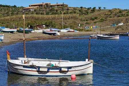 Traditional Catalan boat near a beach in the Mediterranean village of Cadaques, Costa Brava, Spain photo