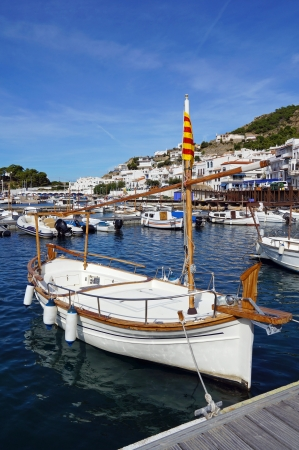 selva: Beautiful traditional Catalan boat at dock in the Mediterranean village of Puerto de la Selva, Costa Brava, Spain