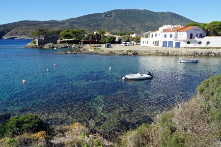 Cove with boats and a house by the sea in the Mediterranean village of Cadaques, Costa Brava, Catalonia, Spain photo