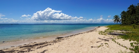 Panorama on an unspoiled island beach with calm waters in the Caribbean sea photo