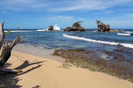 islets: Tropical beach with wave crashing on rocky islets, Caribbean sea, Bocas del Toro, Panama Stock Photo