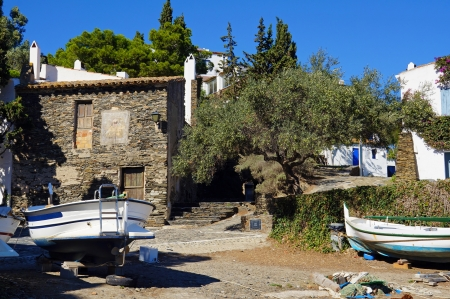 Old Mediterranean fisherman village with Catalan boat out of water, Cadaques village, Costa Brava, Catalonia, Spain Stock Photo - 20239643