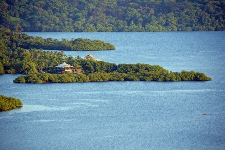 stilt house: Exotic landscape with dusk light over tropical island and house, Bocas del Toro Stock Photo