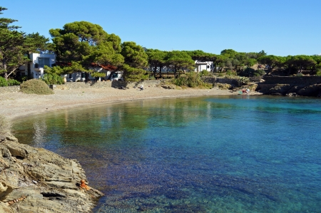 Tranquil cove with clear shallow waters, Mediterranean sea, Cadaques, Costa Brava, Catalonia, Spain