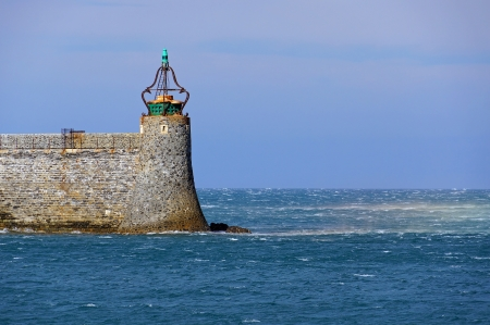 vermilion coast: Green light beacon in Collioure harbor with strong wind on sea surface,Mediterranean, Vermilion coast, Languedoc Roussillon, France