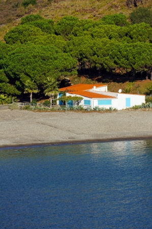 Typical waterfront Mediterranean house with the sea in foreground, cove of Peyrefite, Vermilion coast, Roussillon, France photo