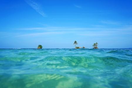 islets: Horizon over water with small islets and coconut tree, Caribbean sea, Zapatillas Keys, Bocas del Toro, Panama Stock Photo